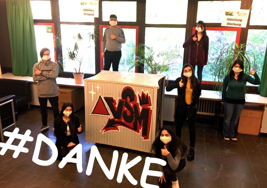 Schüler mit Masken, VSM-Logo
